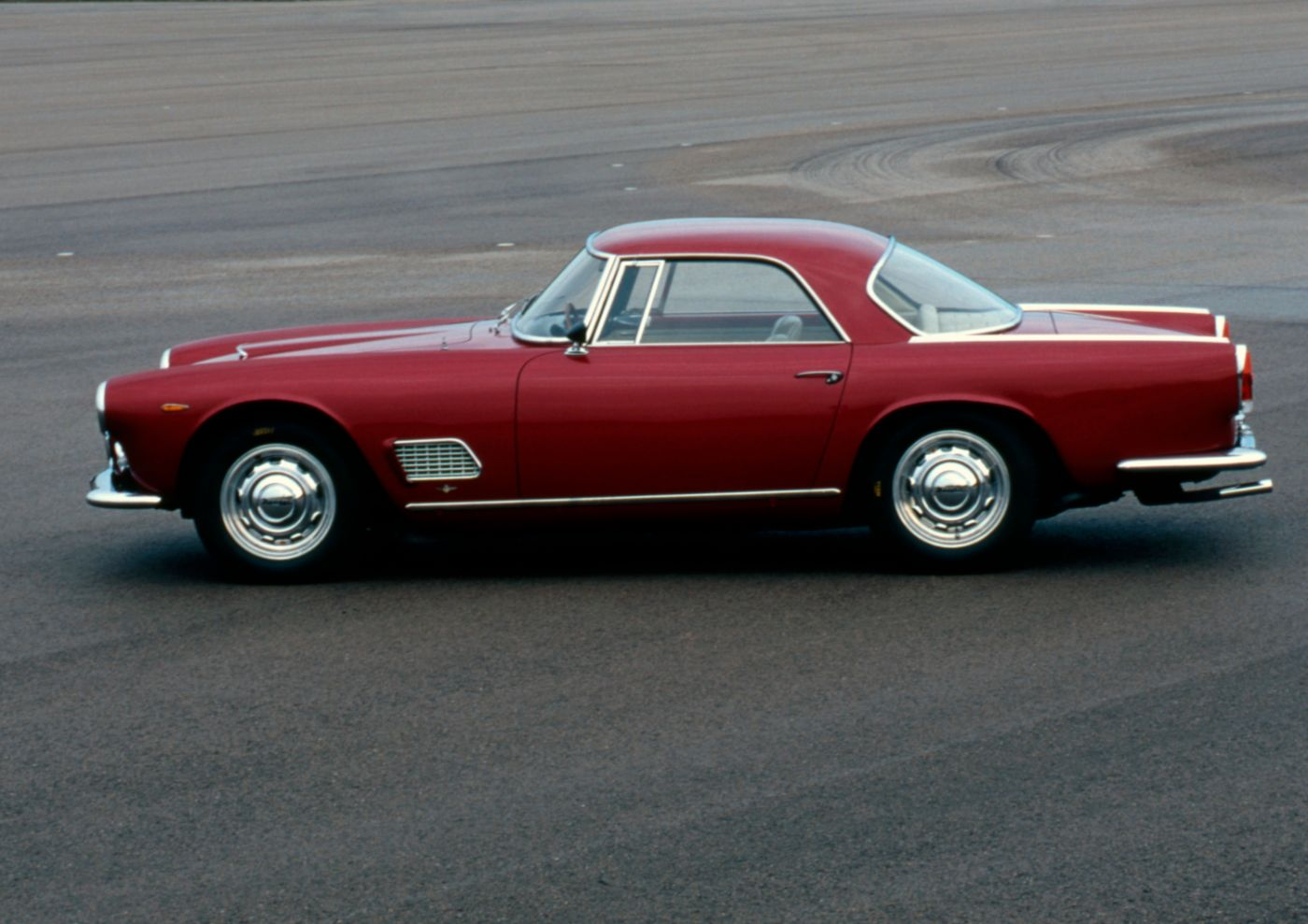 1957 Maserati 3500GT - side view of a classic car model in red