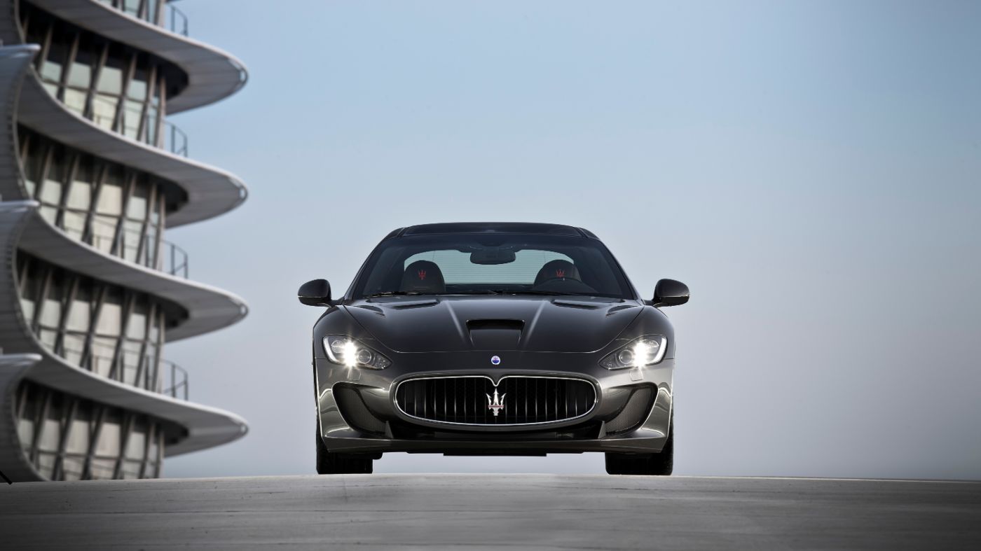 Grey Maserati GranTurismo Hero - Front view - On the road