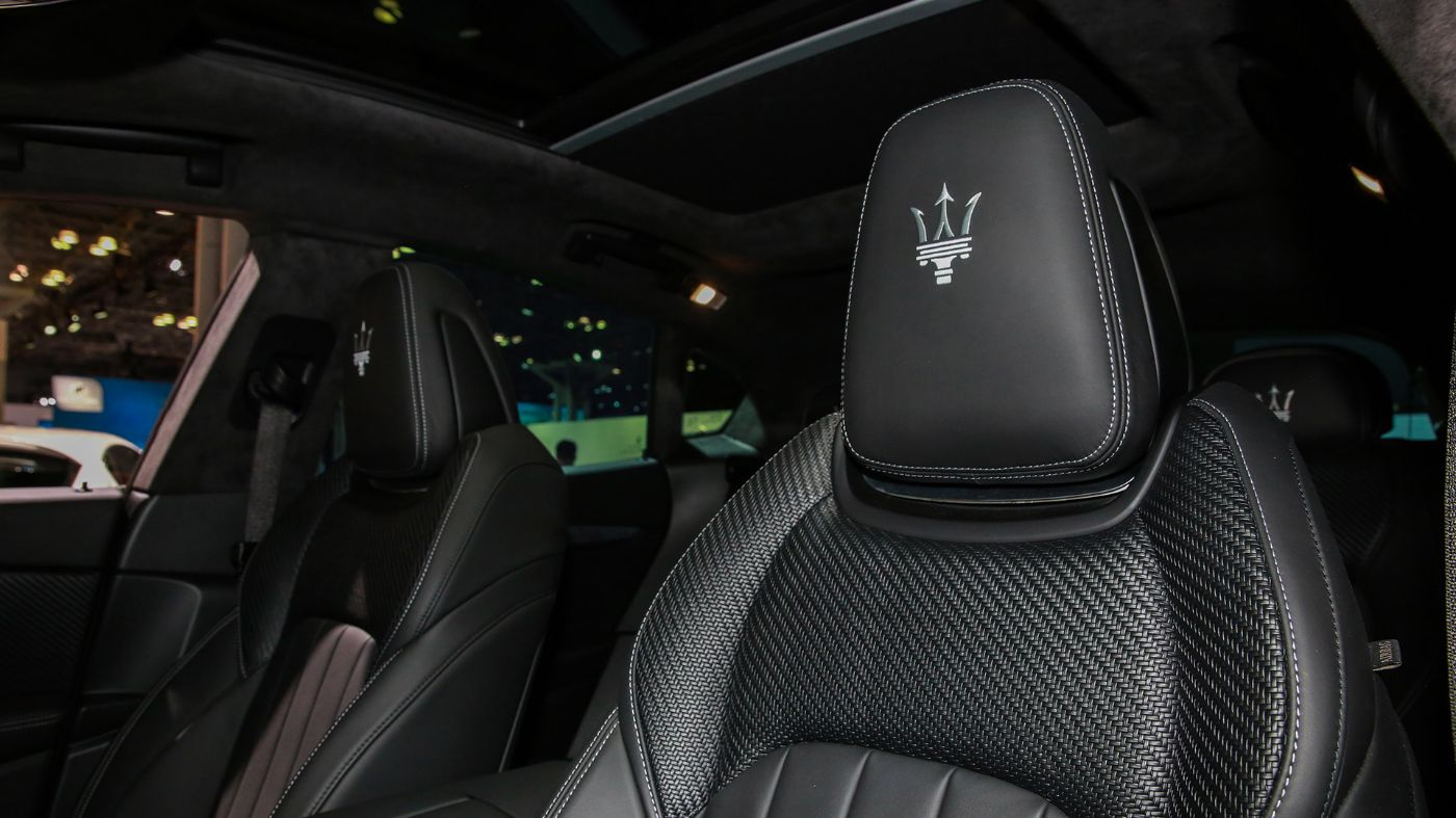 Maserati Zegna Pelletessuta interiors - Detail of woven leather front seat and Maserati logo